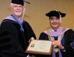 ADI President Ramon Baez congratulates Dr. Dailey on his Honorary Fellowship.