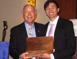 Dr. Terry Tanaka congratulates Michael Siy