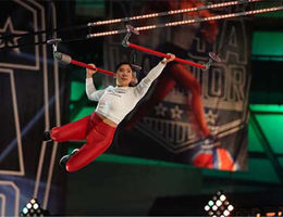Sarah Chang swings from obstacle course bars